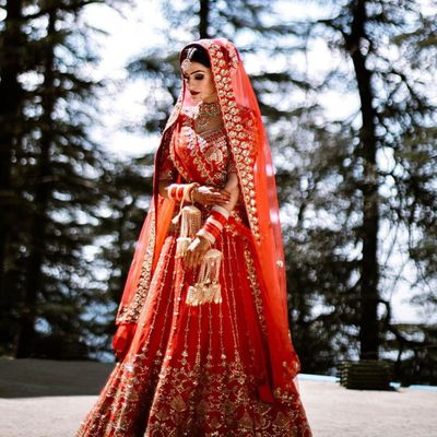 Photo of modern bride in a red lehenga