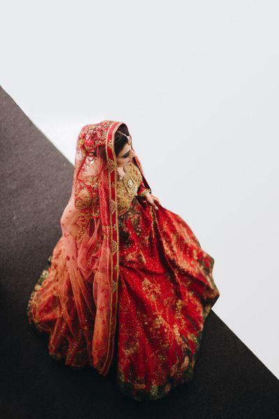 Photo of Top shot deep rust bridal lehenga