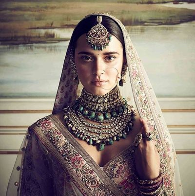 Photo of Sabyasachi bridal jewellery with green beads