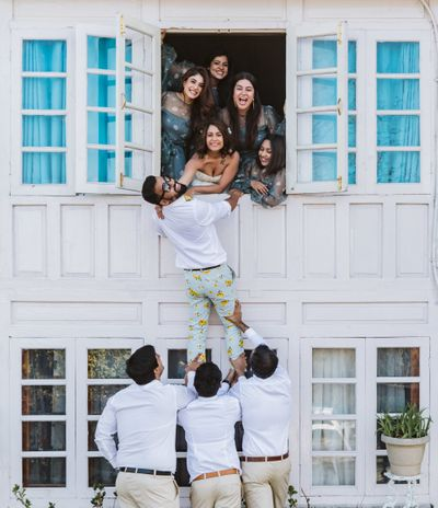 Photo of bridesmaids and groomsmen fun shot