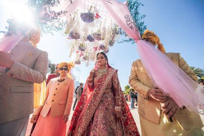 Photo of bridal entry under phoolon ki chadar