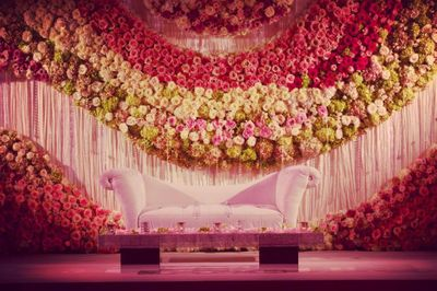 Photo of Stage decor idea for engagement with floral wall