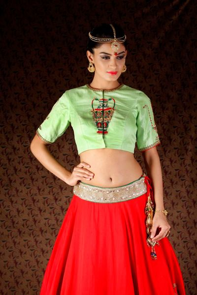 Photo of mint and red lehenga