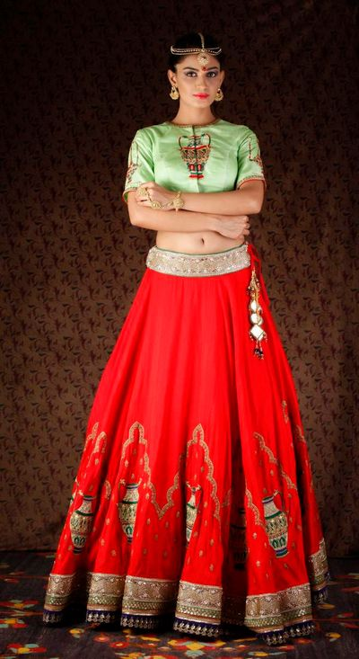 Photo of mint green and red lehenga