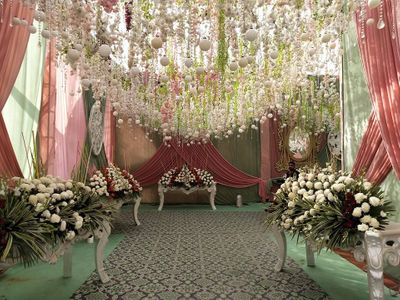 Photo of Grand entrance decor with cascading flowers and flowy drapes.