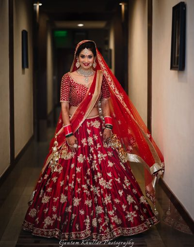 Photo of deep maroon and gold bridal lehenga