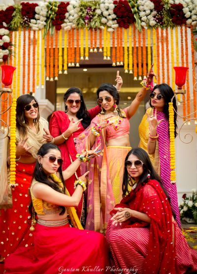 Photo of Bride with friends on mehendi wearing sunglasses