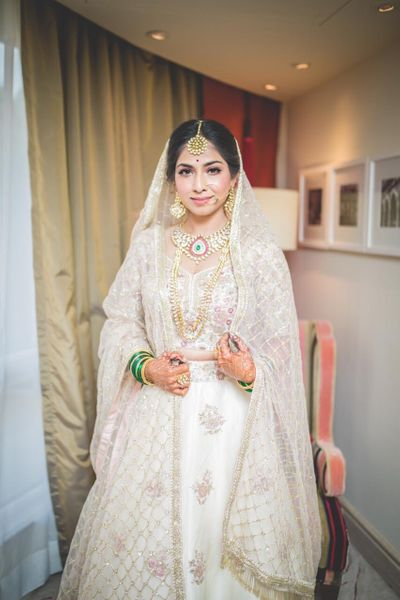 Photo of White bridal lehenga with floral motifs