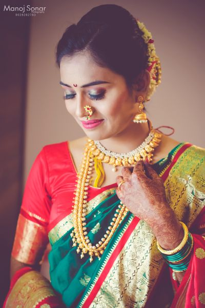 Photo of A Maharashtrian bride in a saree for her wedding day