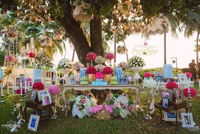 Photo of modern photobooth corner table display idea with lots of props and elements