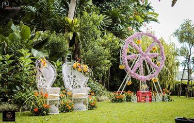 Photo of elegant whimsical mehendi seating idea and floral decor