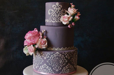 Photo of Pretty floral and lace cut cake for engagement party