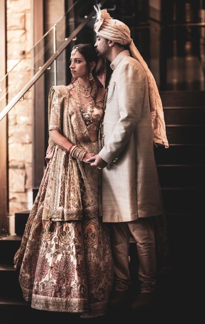 Photo of Coordinated couple portrait in gold outfits