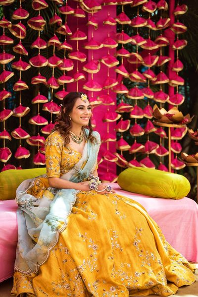 Photo of A to be bride in a yellow mehendi outfit