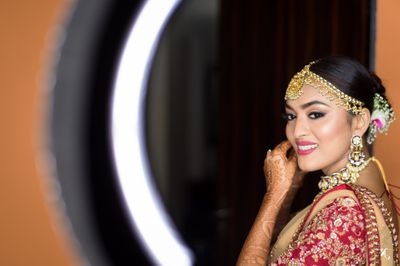 Photo of Fresh bridal makeup with highlit cheeks