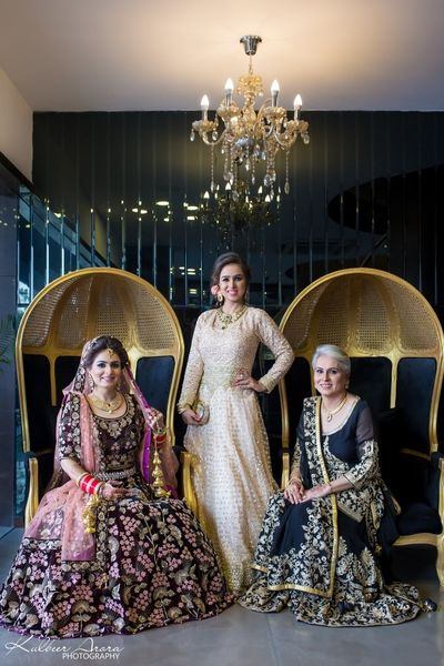 Photo of Bride with mother and sister on wedding day
