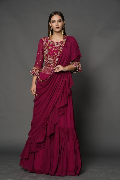Photo of A dark pink saree gown with an embellished bodice.