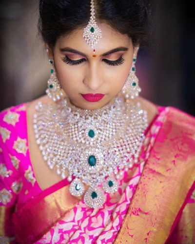 Photo of Diamond and emerald oversized necklace for south indian bride