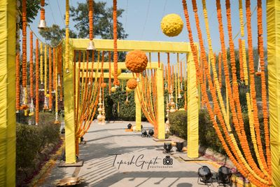Photo of Entrance way decor with marigolds in yellow and orange