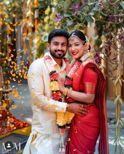 Photo of A south indian couple posing in between their wedding rituals.