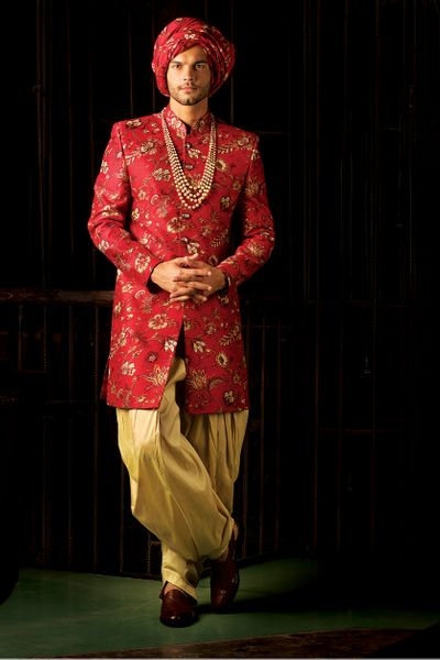 Photo of Red floral sherwani and turban for groom