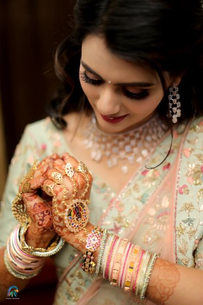 Photo of Bridal hands with colourful haathphool