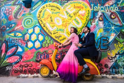 Photo of Cute pre wedding shoot idea with graffiti wall and scooter