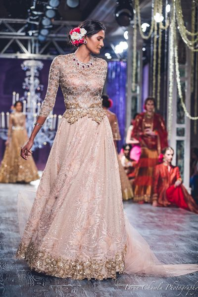 Photo of Tahiliani Shell Pink and Gold Lace Lehenga