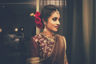 Photo of Beautiful bronze saree with bridal bun with red roses