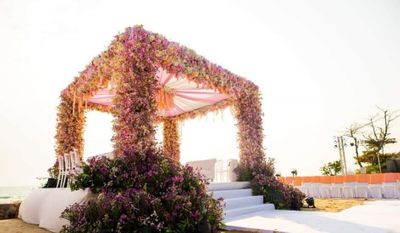 Photo of An open mandap with pink floral decor
