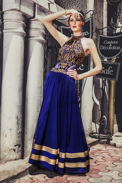 Photo of floor length halter neck high gown with cutaway sleeves