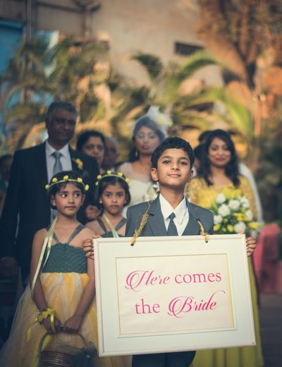 Photo of Bridal Entry With Flower Girls and Message Board