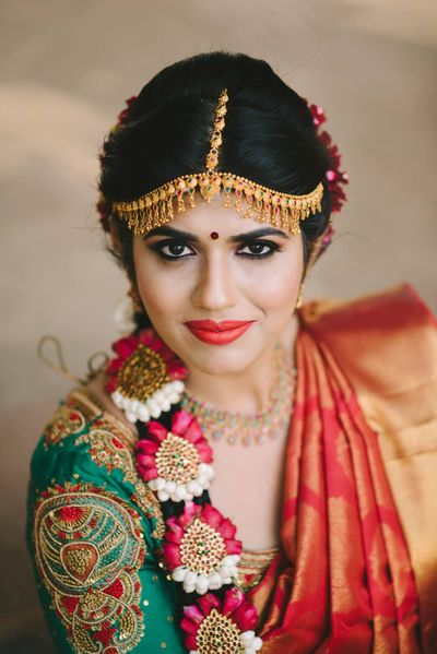 Photo of Bride with South Indian blouse design embroidered