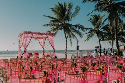 Photo of pink theme decor with mandap and matching chairs