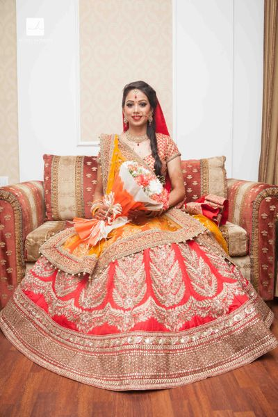 Photo of Mustard and Coral Lehenga with Handcrafted Zardozi Work