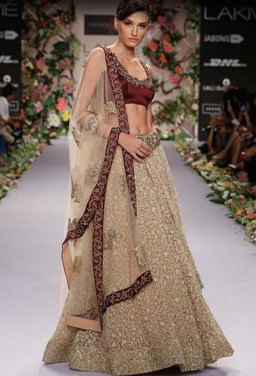 Photo of marsala blouse and gold lehenga with all over embellishment