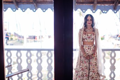 Photo of Bride with open hair and simple floral embroidery lehenga
