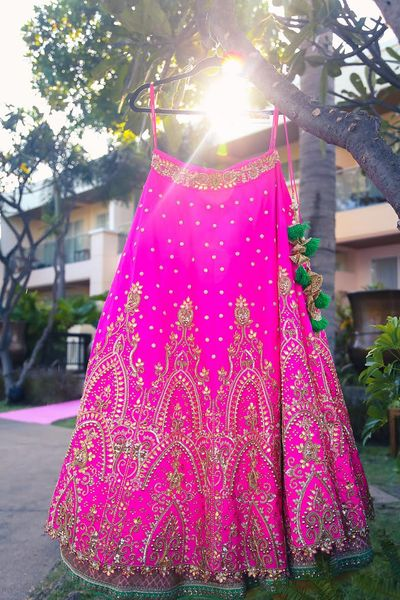 Photo of Fuchsia Pink Lehenga on a Hanger
