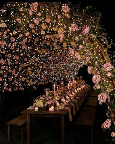 Photo of A night table setting with a floral canopy