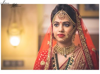 Photo of Red Lehenga with Gold Border and Gold Mathapatti