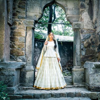 Photo of White peplum lehenga for minimal bride