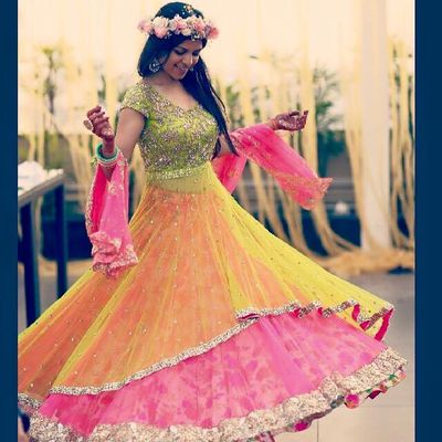 Photo of green yellow and pink layered lehenga
