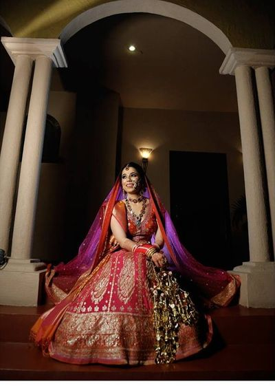 Photo of Maroonish red banarasi lehenga with contrasting dupatta