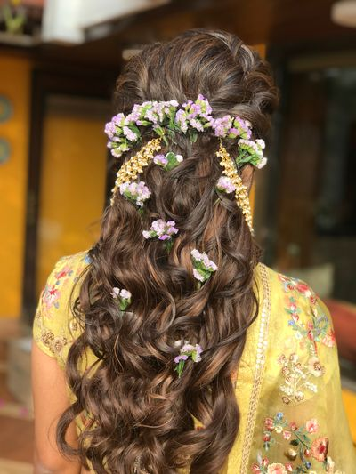 Photo of A bride with soft curls and flowers in her hair