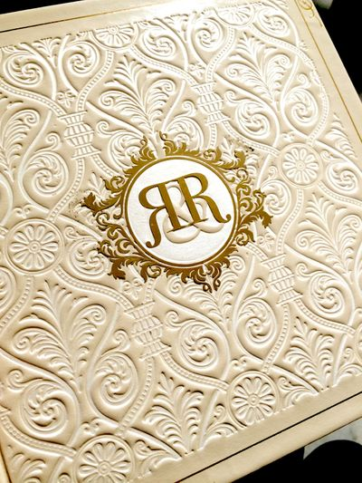 Photo of Elegant white card with initials as motif on card