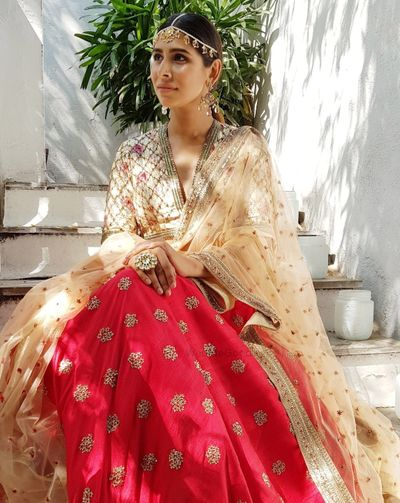Photo of Summer lehenga for bride in red with gold choli