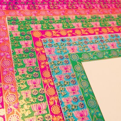 Photo of bright pink and green multicolored border inserts. Indian funky invites