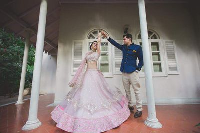 Photo of Couple Dancing with Twirling Bride Shot