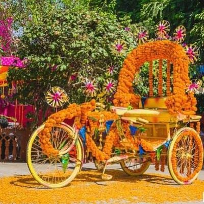 Photo of Floral rikshaw for mehendi decor