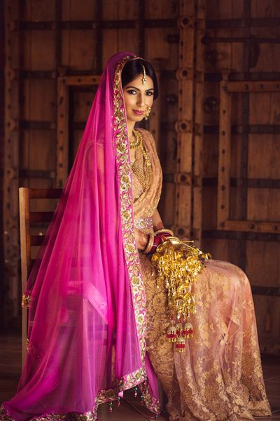 Photo of Unique bridal look with contrasting dupatta